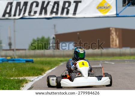 BUCHAREST, ROMANIA - MAY 16: Alexander Prelea, number 4, competes in National Karting Championship, Round 1, on May 16, 2015 in Bucharest, Romania.