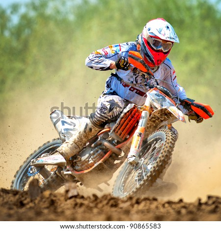BUCHAREST, ROMANIA - MAY 14: An unidentified rider participates in the Third National Endurocross Championship on May 14, 2011 at Ciolpani in Bucharest, Romania - stock photo