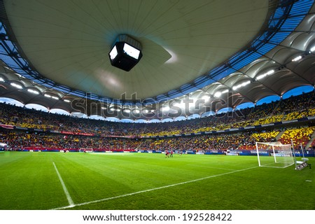 BUCHAREST, ROMANIA - MAY 23, 2012: Bucharest National Arena during the soccer game Romanian Cup Timisoareana, Dinamo Bucharest vs. Rapid Bucharest on May 23, 2012, Bucharest, Romania - stock photo