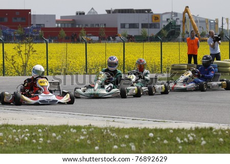 BUCHAREST, ROMANIA - MAY 8: Calin Tariceanu, number 404 competes in South East European Karting Zone Championship on MAY 9, 2011 in Bucharest, Romania.