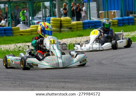 BUCHAREST, ROMANIA - MAY 16: Daniel Vasile, number 99, competes in National Karting Championship, Round 1, on May 16, 2015 in Bucharest, Romania.