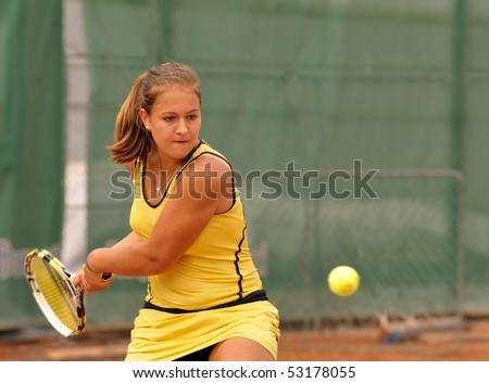 "BUCHAREST, ROMANIA - MAY 16: Romanian Elena Cadar is playing during the second day of qualifications for the F1 Romanian Tennis Futures at ""Dinu Pescariu Club"" on May 16, 2010 in Bucharest, Romania. - stock photo"