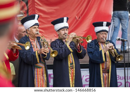 BUCHAREST, ROMANIA - MAY 17: Traditional Ottoman army band members performe at trumpets during the celebratory events Turkish Festival on May 17, 2013 in Bucharest, Romania.