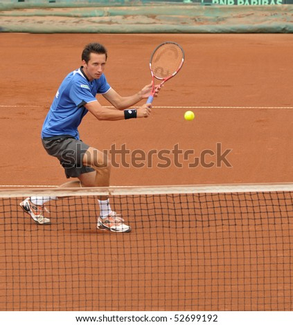BUCHAREST, ROMANIA - MAY 9:  Ukraine's Sergiy Stakhovsky is performing a backhand during the fourth match of the Davis Cup meeting between Romania and Ukraine at the BNR Arenas on May 9, 2010 in Bucharest, Romania. - stock photo