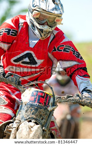 BUCHAREST, ROMANIA - MAY 14: Unidentified rider participates in the Third National Endurocross Championship on May 14, 2011 at Ciolpani in Bucharest, Romania