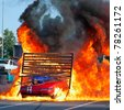 BUCHAREST, ROMANIA - MAY 29: Unknown driver and stuntman pass through fire with his car during the  ''Stunt Cars Show'' on May 29, 2011 in Bucharest, Romania - stock photo