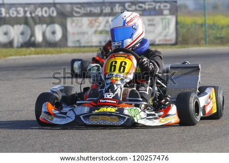 BUCHAREST, ROMANIA - NOV. 11: Victor Supuran, number 66, competes in Karting Cup Romania, on november 11, 2012 in Bucharest, Romania.