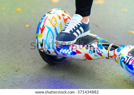 BUCHAREST, ROMANIA, - NOVEMBER 10, 2015: Girl using hoverboard, a self-balancing two-wheeled board. The gyroscope based dual wheel electric scooter is also called a smart balance wheel.
