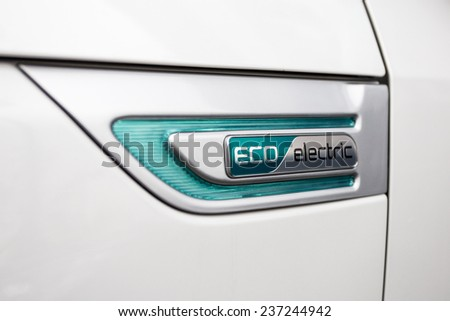 BUCHAREST, ROMANIA - NOVEMBER 28, 2014: Logo of Kia Soul EV electric system in Bucharest, Romania. Kia is South Korea's second-largest automobile manufacturer. - stock photo
