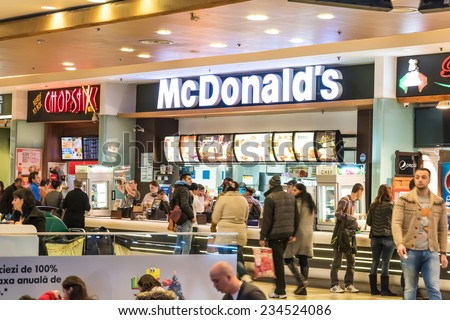 BUCHAREST, ROMANIA - NOVEMBER 30, 2014: People buying fast-food from McDonald's Restaurant In Shopping Mall. - stock photo