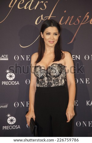 "BUCHAREST, ROMANIA - OCT 27, 2014:  Romanian TV presenter Simona Patruleasa arrives at ""Gala The One"", 10 years of inspiration on October 27, 2014 in Bucharest, Romania. - stock photo"
