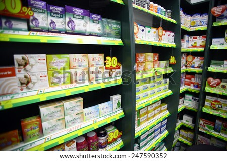 Bucharest, Romania - October 23, 2014: Color shot of some shelves filled with medicine in a pharmacy in Bucharest, Romania.