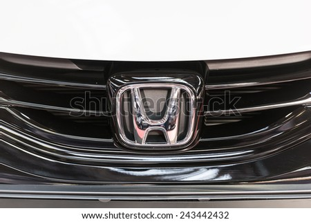 BUCHAREST, ROMANIA - OCTOBER 31, 2014: Honda Sign Close Up. Since 1959 is a Japanese public multinational corporation primarily known as a manufacturer of automobiles, motorcycles and power equipment. - stock photo