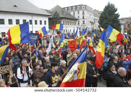 "BUCHAREST, ROMANIA - OCTOBER 19, 2016: Hundreds of persons are claiming in the march ""Fight for Basarabia"", a country project project the union between Romania and the Republic of Moldova."