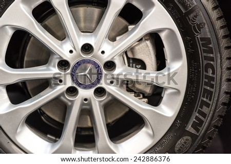 BUCHAREST, ROMANIA - OCTOBER 31, 2014: Mercedes Benz Sign On Wheel And Break Pad. Founded in 1926 is a German luxury automobile manufacturer,a multinational division of German manufacturer Daimler AG. - stock photo