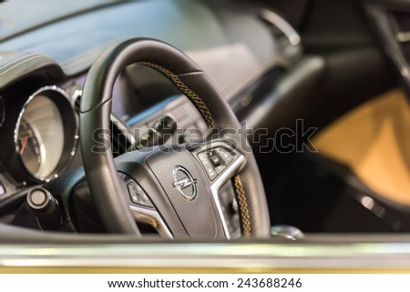 BUCHAREST, ROMANIA - OCTOBER 31, 2014: Opel Car Inside View. Adam Opel AG is a German automobile manufacturer headquartered in Germany and began manufacturing its first automobile in 1899. - stock photo