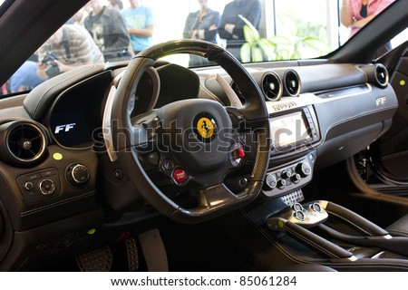 BUCHAREST, ROMANIA -  SEPT. 20:Romanian Ferrari importer Forza Rossa launches new Ferrari model Four (FF) on Sept 20, 2011 in Bucharest.The model was launched by former F1 driver Giancarlo Fisichella. - stock photo