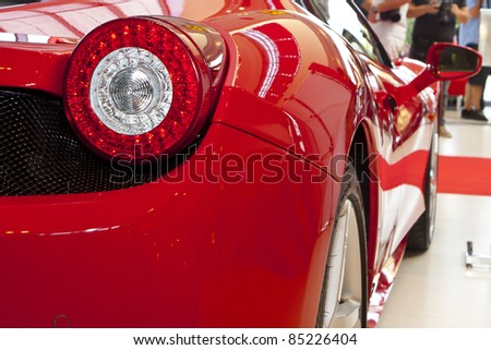 BUCHAREST, ROMANIA - SEPT.20:Romanian Ferrari importer Forza Rossa launches new Ferrari model Four (FF) on Sept 20, 2011 in Bucharest.The model was launched by former F1 driver Giancarlo Fisichella. - stock photo