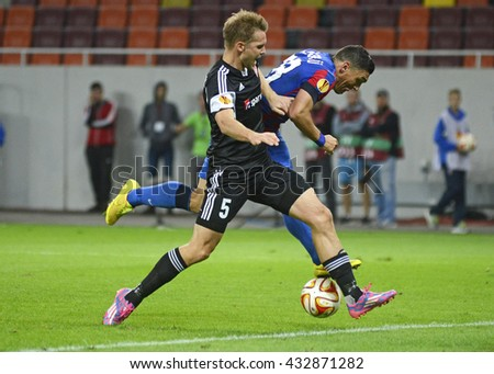 BUCHAREST, ROMANIA - SEPTEMBER 18, 2014: Kenneth Emil Petersen and Claudiu Keseru pictured during the UEFA Europa League game between Steaua Bucuresti and Aalborg on National Arena. - stock photo