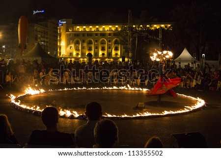 BUCHAREST, ROMANIA - SEPTEMBER 13: Lara Castiglioni performs Neige de Feu show during B-FIT in the Street, International Street Theater Festival on  September 13, 2012 in Bucharest, Romania. - stock photo