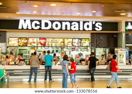 BUCHAREST, ROMANIA - SEPTEMBER 14: People buying fast-food from McDonald's Restaurant on September 14, 2012 in Bucharest, Romania. McDonald's is the main fast-food restaurant chain in Romania. - stock photo
