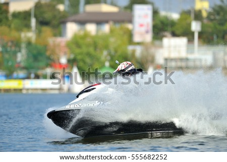 BUCHAREST, ROMANIA -SEPTEMBER 23: Professional jet ski riders compete at the Palazz Jet Ski Championship 2016 at Fundeni lake in Bucharest, on september 23, 2016 in Bucharest, Romania