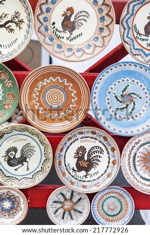 "BUCHAREST, ROMANIA - SEPTEMBER 14, 2014: Traditional painted plates of Horezu area, Romania, exhibited at the ""Rural Fest"" - stock photo"