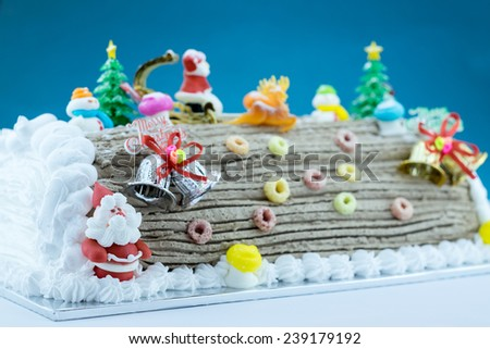 Buche De Noel, Christmas cake with decoration Santa Clause, bell, snow,...for greeting season - stock photo