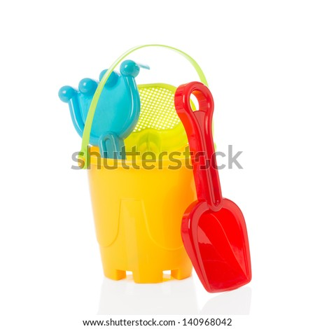 Bucket and spade for the beach on a white background