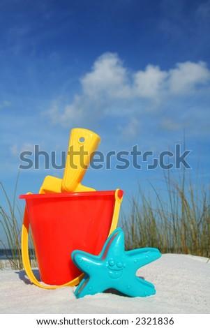 Bucket and Spade on the seashore - stock photo