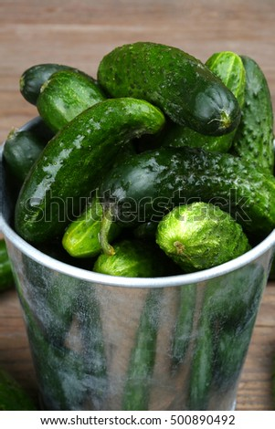 bucket filled with gherkins close up, shallow dof