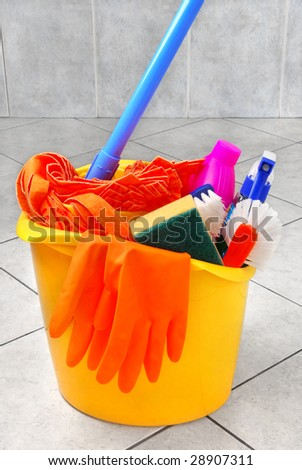 Bucket full of cleaning supplies - stock photo