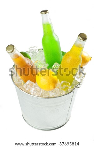 Bucket full with ice cubes with wet bottles and fruits on white background - stock photo