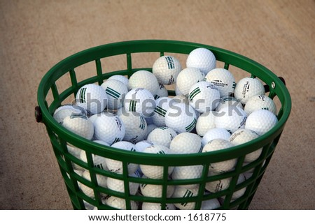 Bucket of Practice Golf Balls - stock photo