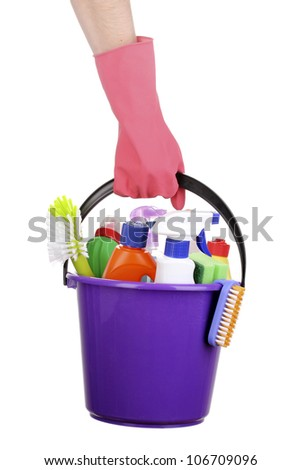Bucket with cleaning items in hand isolated on white