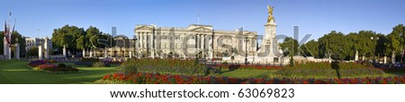 Buckingham Palace and Victoria Memorial in London, home to the Queen of England. Panoramic image with clear sky. - stock photo