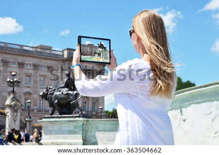 Buckingham Palace on the screen of a tablet pc - stock photo
