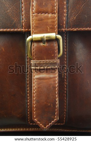buckle on leather briefcase - stock photo