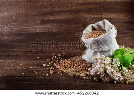 Buckwheat and buckwheat flowers on a wooden surface