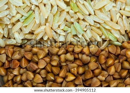 buckwheat and rice background close up - stock photo