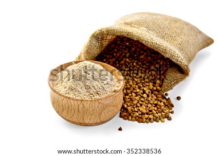 Buckwheat flour in a wooden bowl, buckwheat in the bag isolated on white background - stock photo