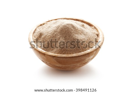 buckwheat flour in bowl isolated on white background