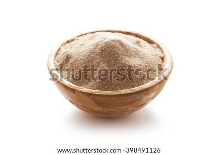 buckwheat flour in bowl isolated on white background - stock photo