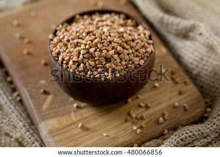 buckwheat groats on wooden surface