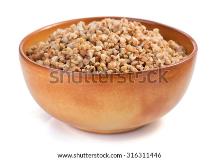buckwheat in bowl isolated on white background - stock photo