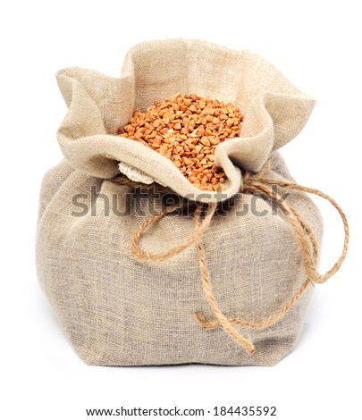 Buckwheat in the sack isolated on white - stock photo