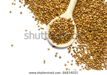 Buckwheat in wood spoon - stock photo