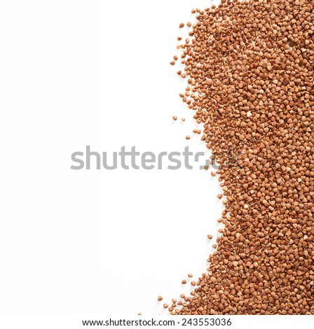 Buckwheat is sprinkled / premium buckwheat groats on white background  - stock photo