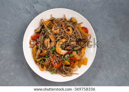Buckwheat noodles with seafood and vegetables, top view, horizontal - stock photo