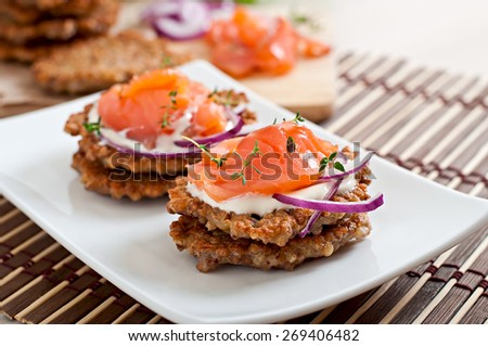 Buckwheat pancakes with salted salmon and sour cream close up - stock photo